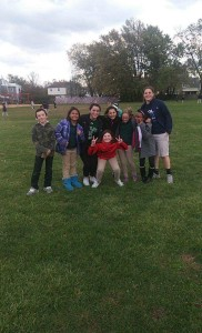 Photo by Christine Burns Peer Mentors Brenna Harrison and Marykate Cowan play with kids at recess at Woodlyn Elementary